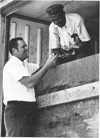 Bill Bennion (left), Southern's district sales manager and Leonard Henderson, Tem-Cole's facility foreman